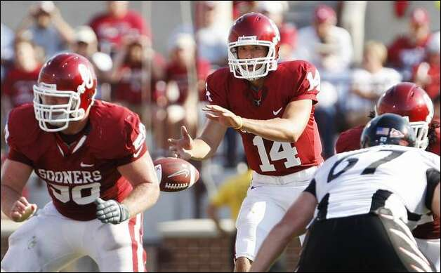 Oklahoma quarterback Sam Bradford threw for a career-best 395 yards and five touchdowns against Cincinnati last Saturday. Photo: Sue Ogrocki/Associated Press