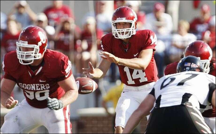 Oklahoma quarterback Sam Bradford threw for a career-best 395 yards and five touchdowns against Cincinnati last Saturday. Photo: Sue Ogrocki/Associated Press