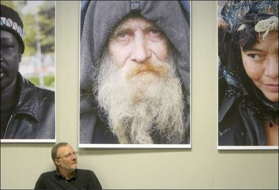 "Some of David Entrikin's photographs of Seattle's homeless from his show ""Outsiders"" is seen in the gallery space above his bookcase shop in Ballard. Photo: Mike Kane/Seattle Post-Intelligencer"