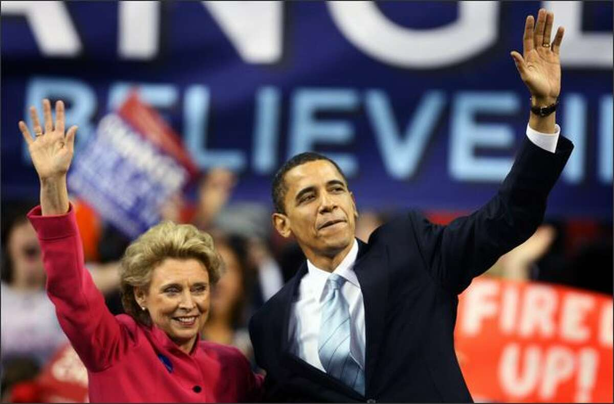 Democratic presidential candidate Sen. Barack Obama is introduced by Washington State Governor Chris Gregoire during a rally at Key Arena in Seattle.