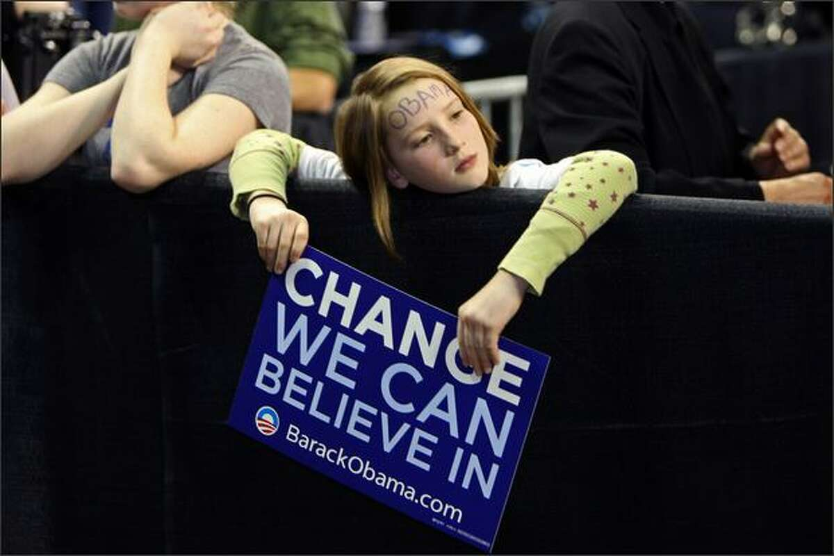 A young Barack Obama supporter patiently awaits the senator's arrival at Key Arena during his speech in Seattle.