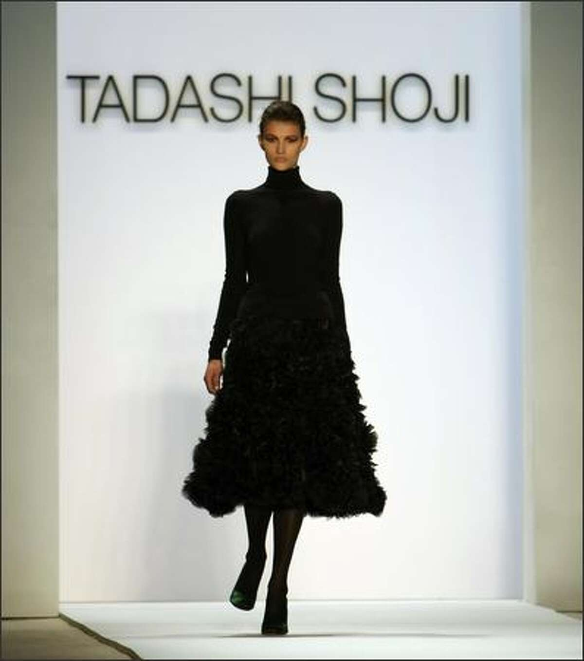 A model displays a outfit from Tadashi Shoji during the Fall 2008 fashion show during Mercedes-Benz Fashion Week Fall 2008 at The Promenade at Bryant Park in New York City.
