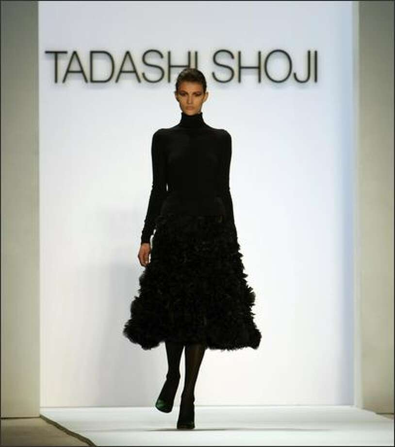 A model displays a outfit from Tadashi Shoji during the Fall 2008 fashion show during Mercedes-Benz Fashion Week Fall 2008 at The Promenade at Bryant Park in New York City. Photo: Getty Images