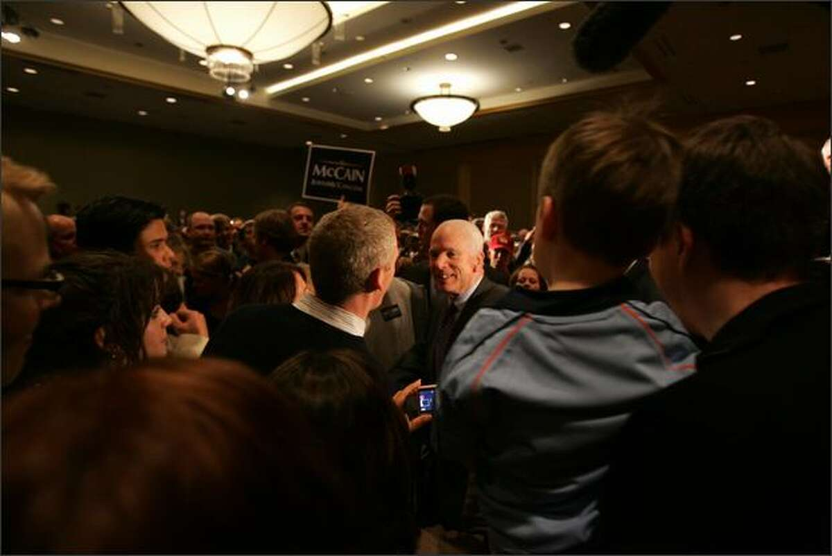 Republican presidential candidate Senator John McCain greets supporters during a rally at the Westin Hotel in Seattle.