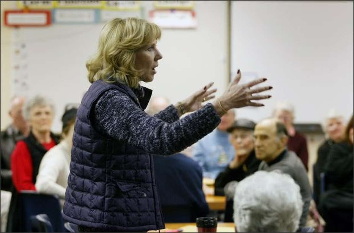 Diane Tebelius, former chairperson of the Washington State GOP, explains the rules at the start of a Republican caucus at Spiritridge Elementary School in Bellevue.