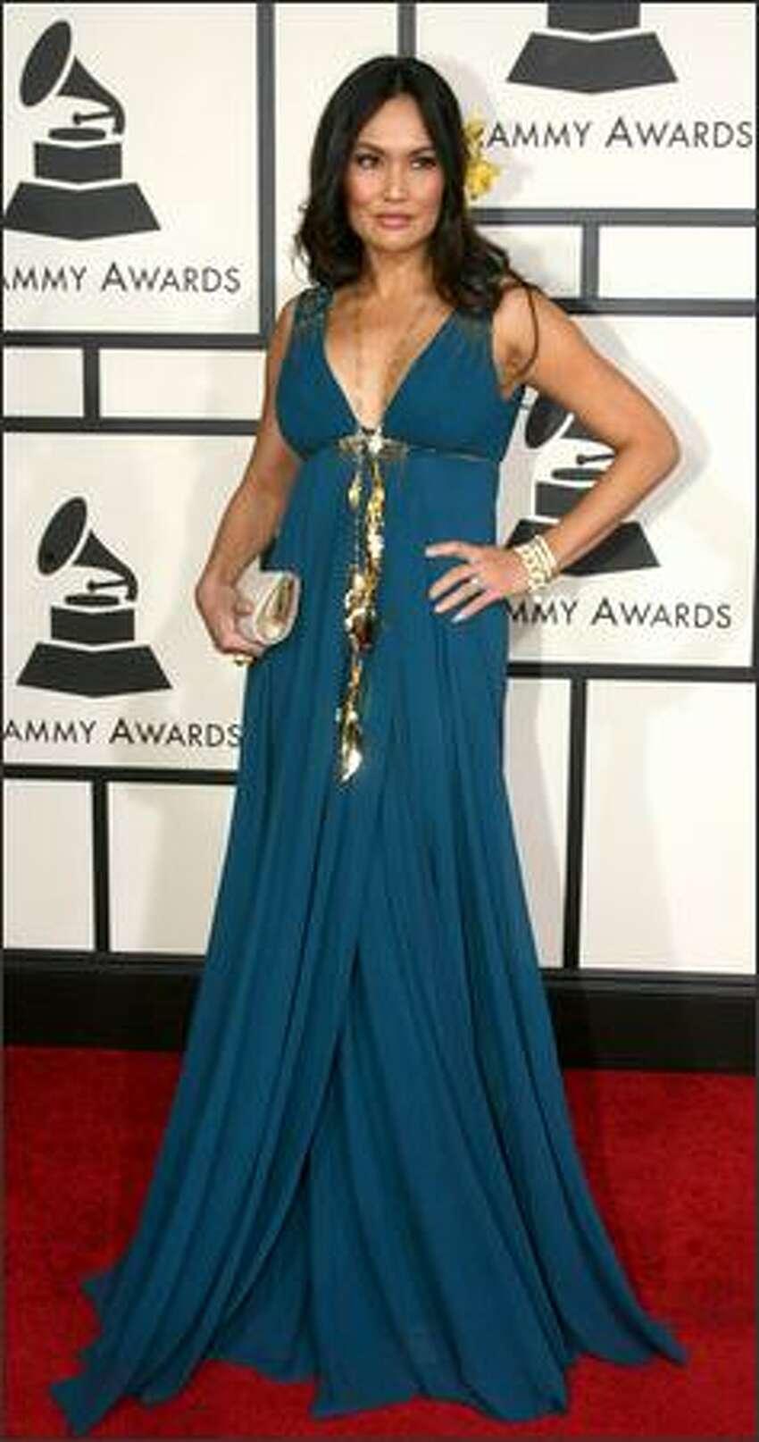 Singer/actress Tia Carrere arrives.