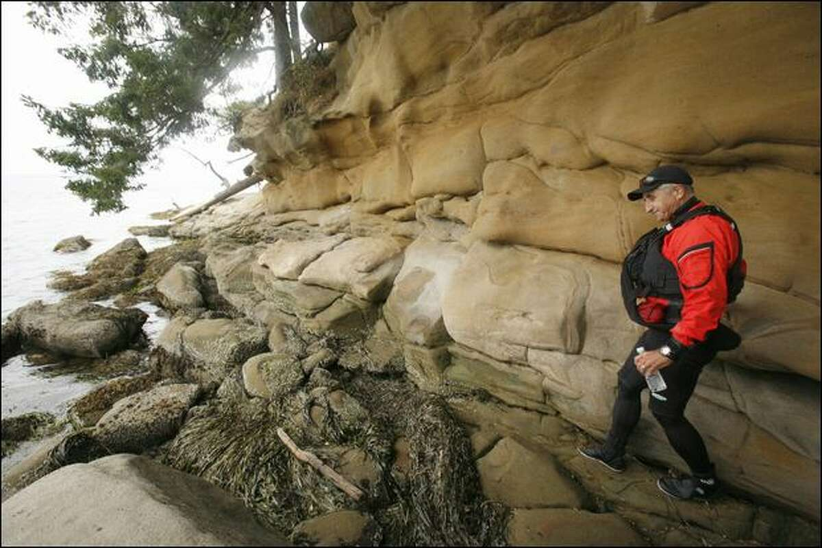 Gene Davis takes a closer look at the sculpted sandstone shoreline of Chuckanut Island.