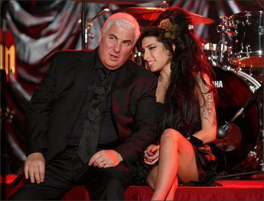 Amy Winehouse sits with her father Mitch as they await news of her Grammy Award.