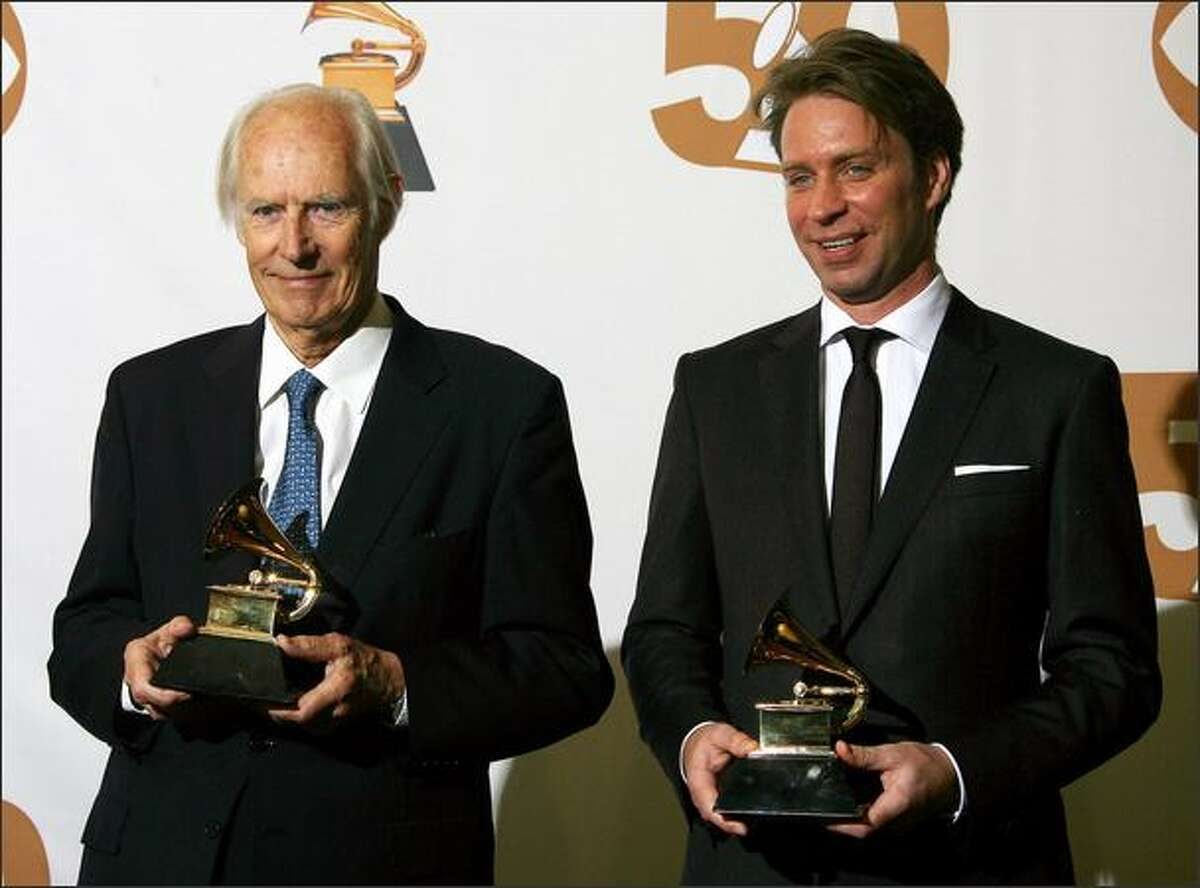 Legendary Beatles producer George Martin and his son, Giles Martin, pose with the Grammys for best compilation soundtrack album and best surround sound album.