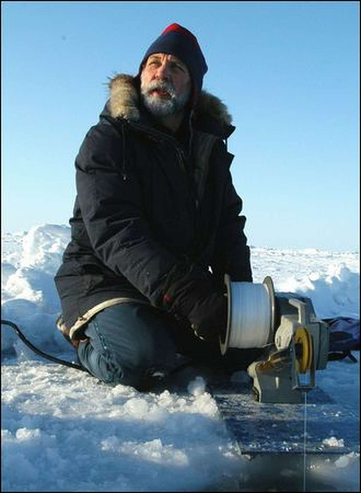 UW oceanographer and polar expert Jamie Morison, seen testing Arctic sea ice in 2003, has seen dramatic changes in the ice after more than three decades of research trips to the North Pole. The rapid melting of the sea ice also has affected his research.