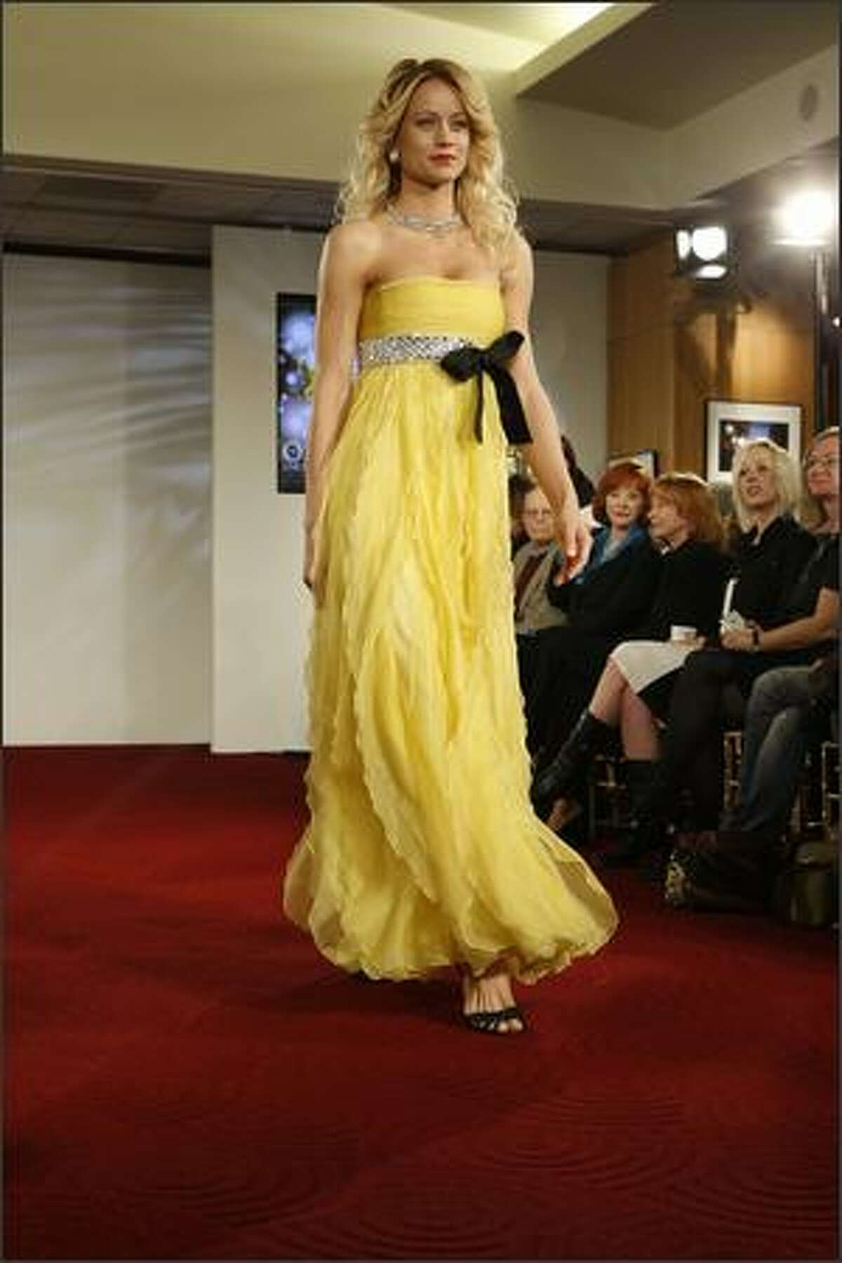A model walks the runway at the Oscar Fashion Show at the Academy of Motion Pictures Arts and Sciences on Wednesday in Beverly Hills, Calif.