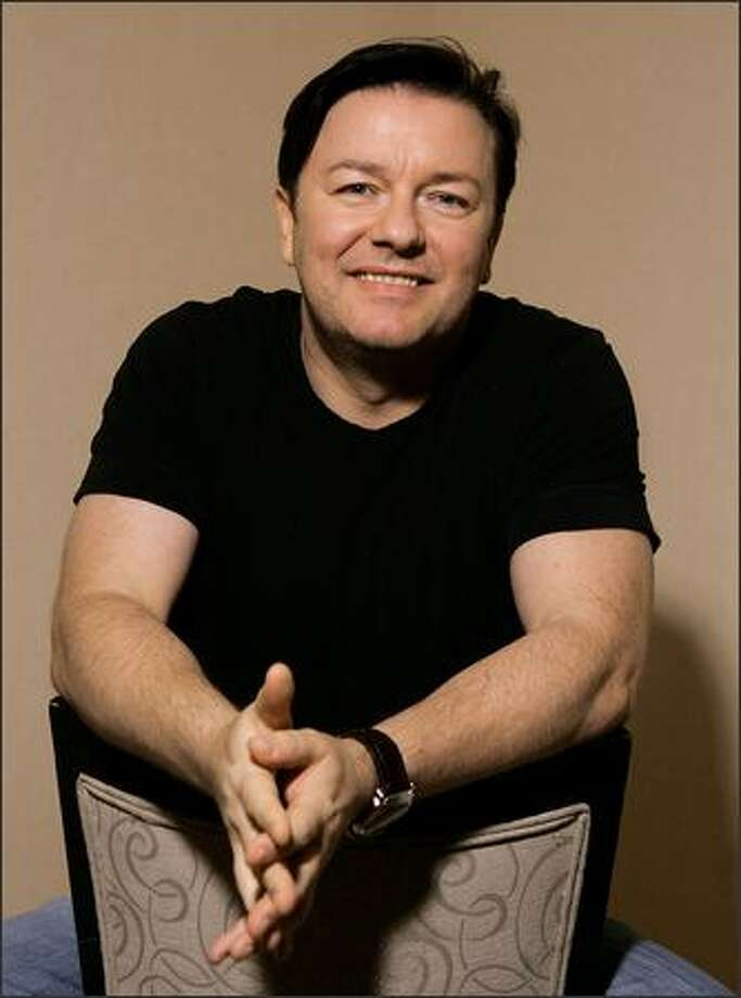 Actor Ricky Gervais poses for a portrait during the International Film Festival in Toronto. (AP Photo/Carlo Allegri) Photo: / Associated Press