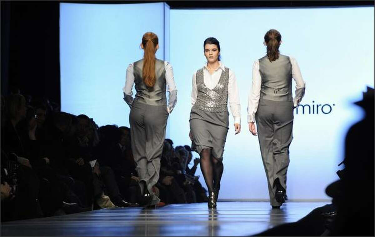 Models display creations by Italian fashion designer Elena Miro during the fall 2008 women's collections at Milan Fashion Week.