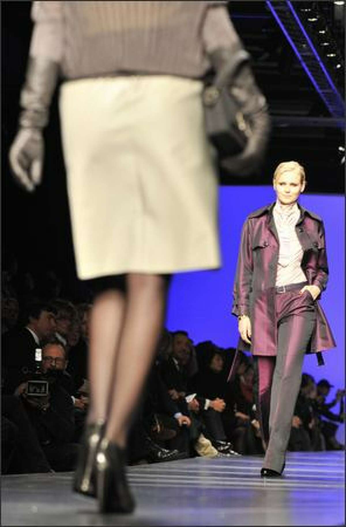 Models display creations by Elena Miro.