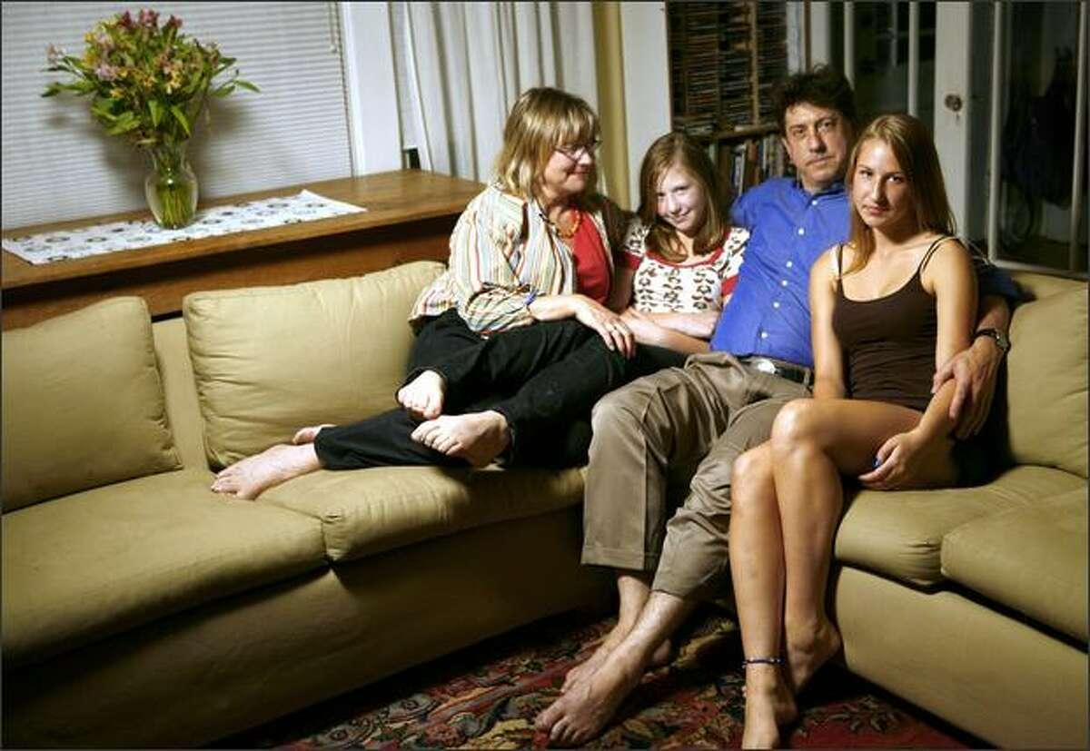 Kristina Hagman, far left, poses with daughter Nora Masler, 12, husband Daniel Masler and daughter Kaya Masler, 16, in their Seattle home.