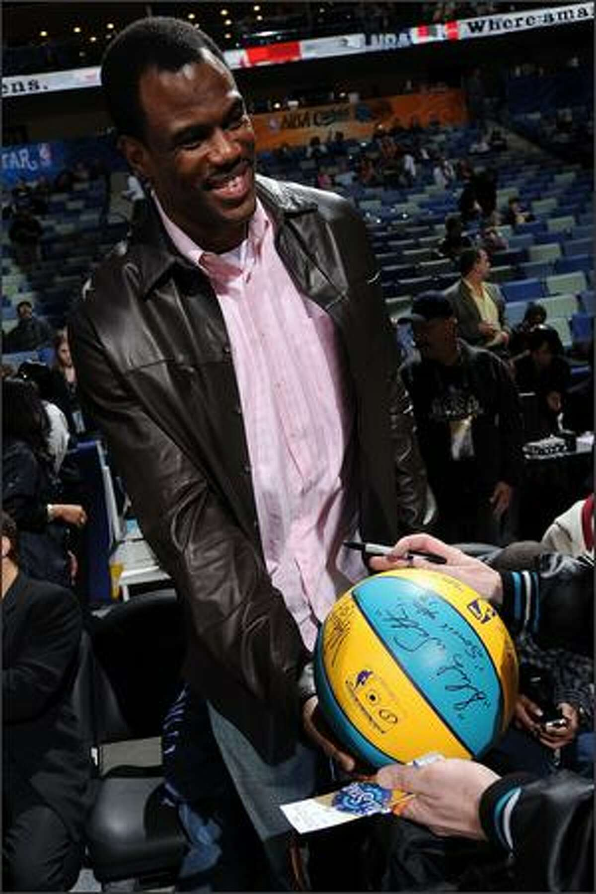 NBA legend David Robinson signs an autograph prior to the start of the 2008 NBA All-Star Game in New Orleans.