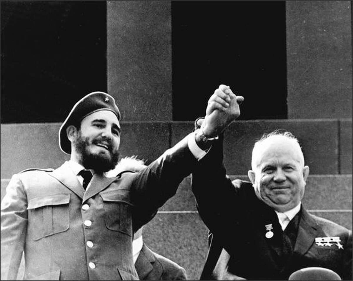 Cuban President Fidel Castro holds the hand of Soviet leader Nikita Khrushchev during an offical visit to Moscow in May 1963. AFP/Getty Images