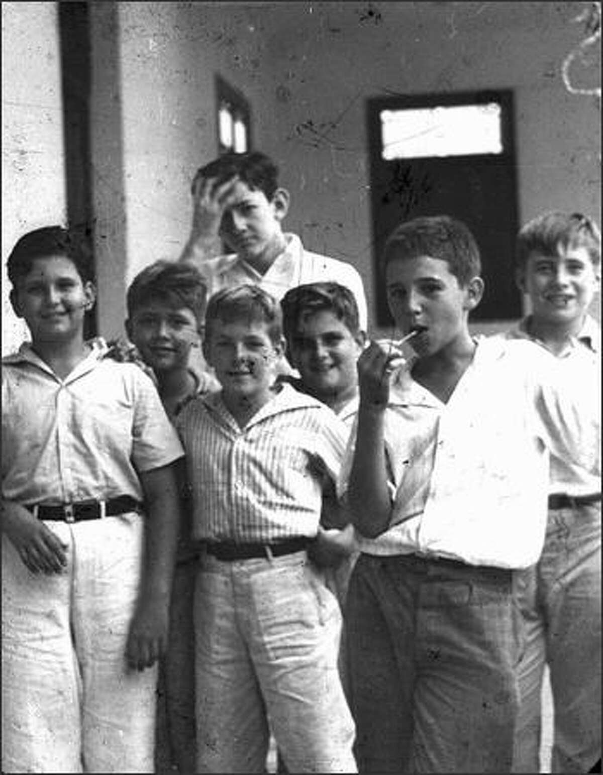 Fidel Castro, right, eats a lollipop in a 1940 photo taken of him and schoolmates when he was studying at the school Nuestra Senora de Dolores in Santiago de Cuba. The photo was taken by Spanish Jesuit Jose Maria Patac. JOSE MARIA PATAC/AFP/Getty Images
