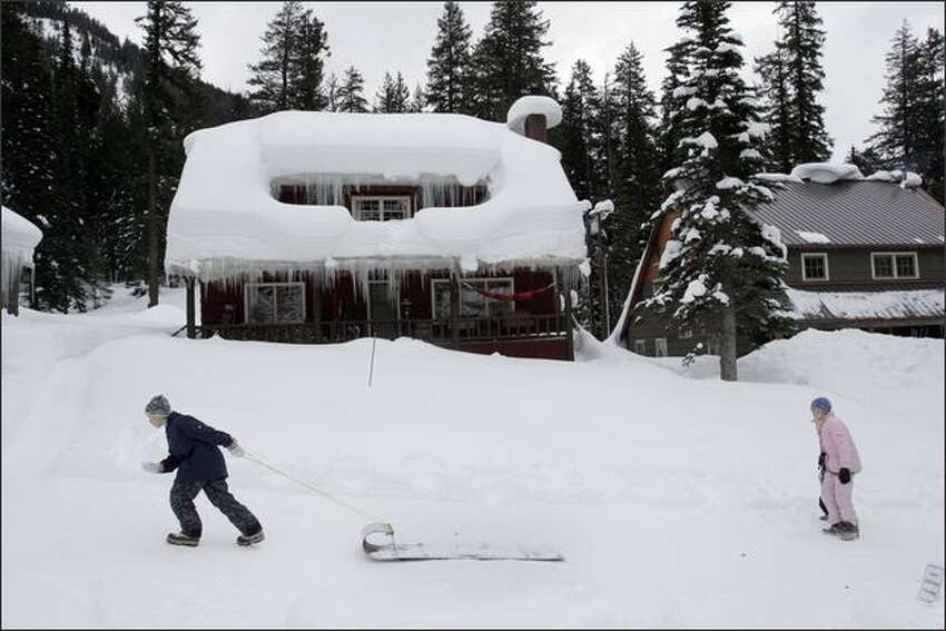 Children walk up Chalet Hill, where Holden Village residents live, so they can sled down on January 20, 2008.