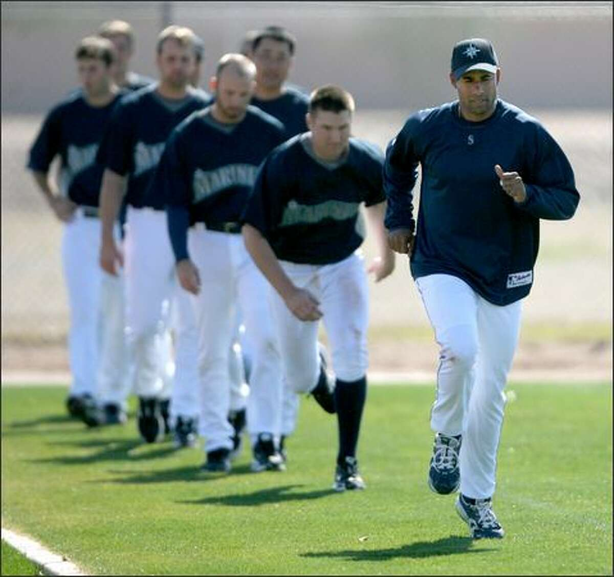 Miguel Batista works on conditioning during the Seattle Mariners workout on the second day of full-squad worksouts in Peoria, Ariz.