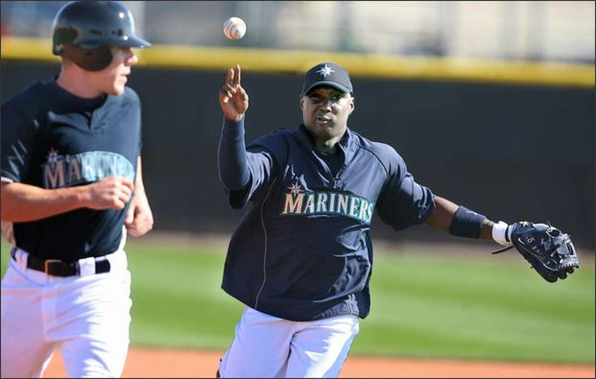 Shortstop Yunieski Betancourt works on run down situations at the Seattle Mariners workout on the second day of full-squad worksouts in Peoria, Ariz.