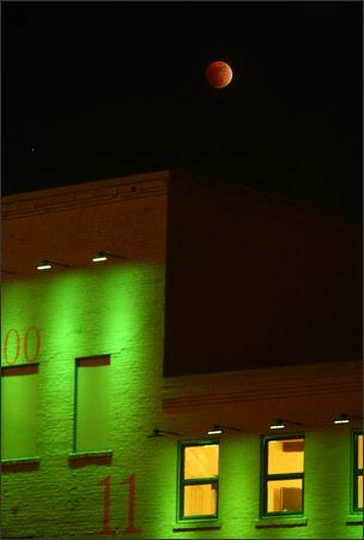 A lunar eclipse as seen above the X Gym building on Western Avenue in downtown Seattle Wednesday night, Feb. 20, 2008.