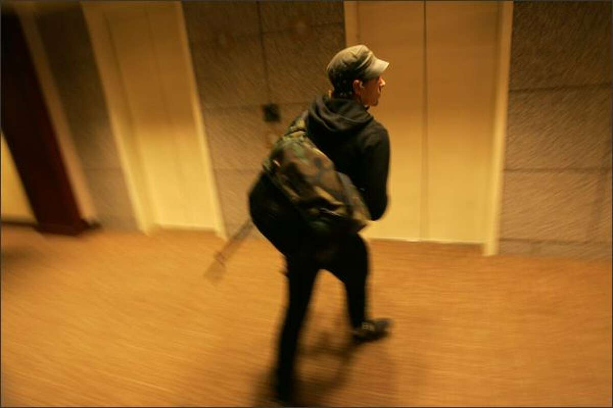 Bike messenger Ross Miller heads out of an elevator for a delivery in the US Bank Centre building in Seattle.