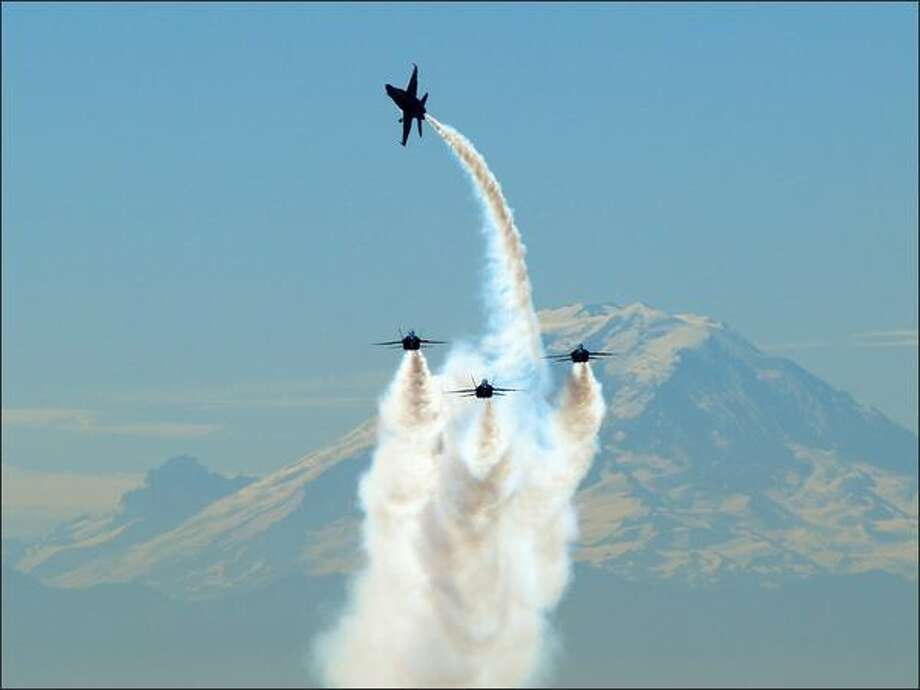 Photographer: See more by VladMedEditor's comment: Our own staff photographer Joshua Trujillo had a similar photograph of the Blue Angels during Seafair in 2007, which we published on the front page of the newspaper. I would have also published this picture.