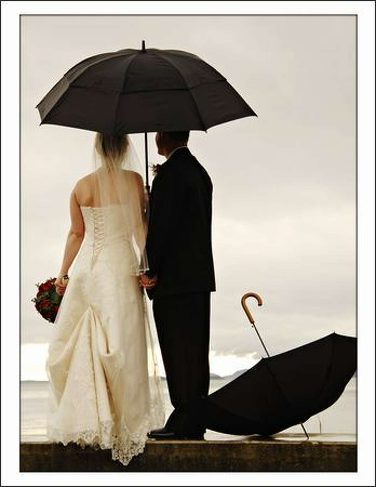 Photographer : See more by Evantide Editor's comment: The umbrellas balance the frame nicely. And the feeling of the couple looking away adds to its magic.
