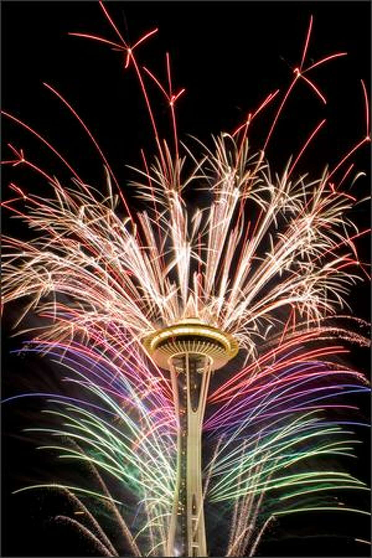 Photographer : See more by ChrisB Editor's comment: This is probably one of the best fireworks pictures taken from this point of view of the Space Needle.