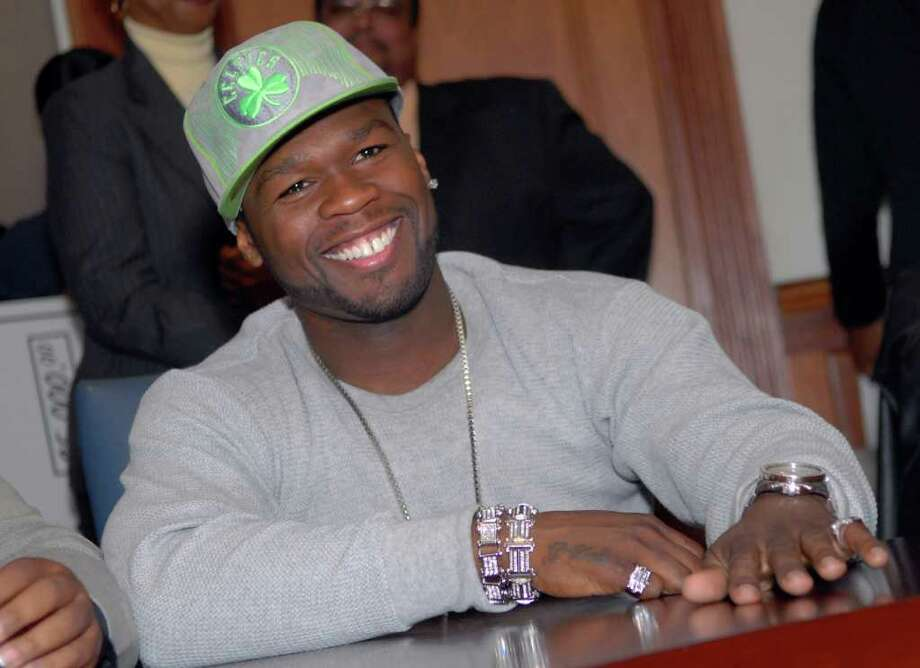 FILE - Rapper 50 Cent visited the  Mayor's office in Bridgeport on October of 2007, where he met with a group of students from Central High School, who asked him questions and posed for pictures with the famous rapper. Photo: File Photo / Greenwich Time File Photo