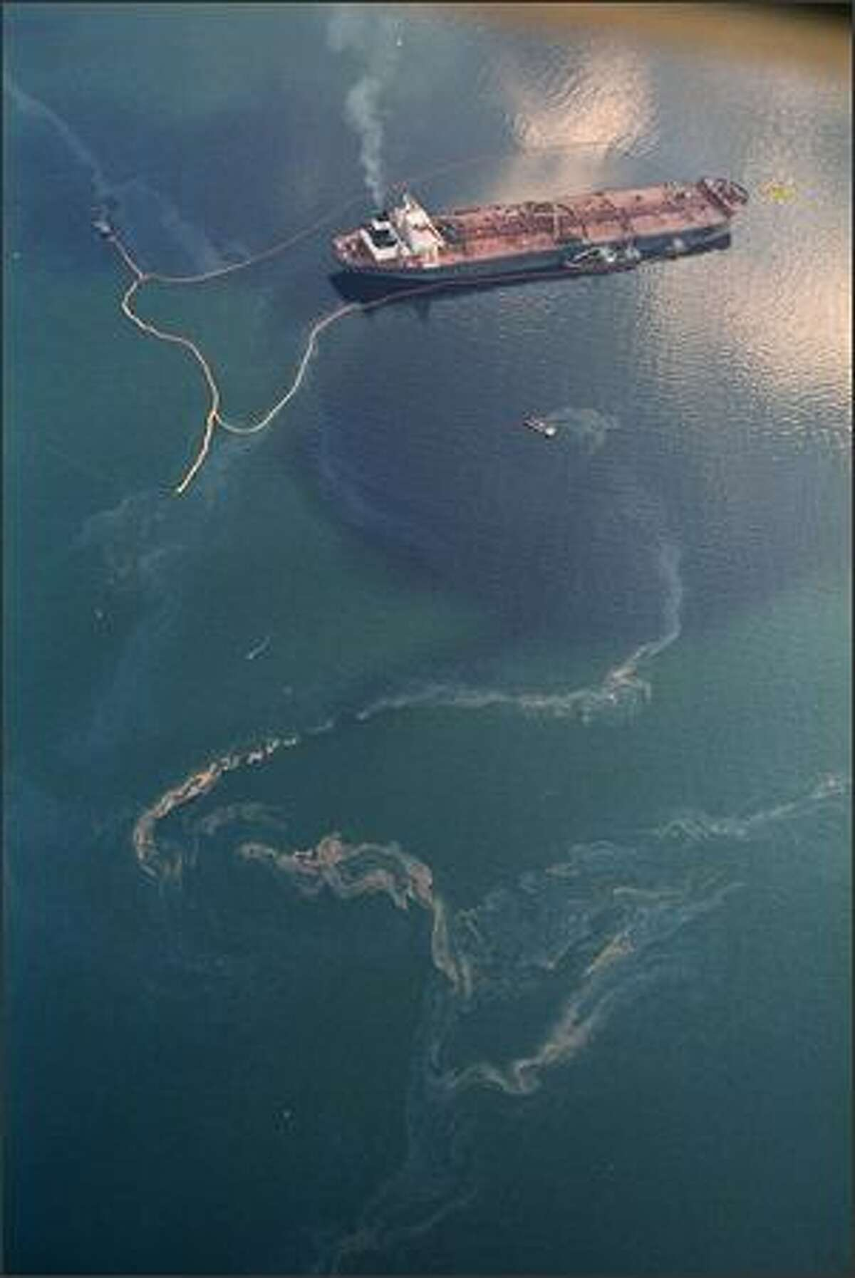 Crude oil from the tanker Exxon Valdez swirls on the surface of Alaska's Prince William Sound near Naked Island Saturday, April 9, 1989, 16 days after the tanker ran aground, spilling millions of gallons of oil and causing widespread environmental damage.
