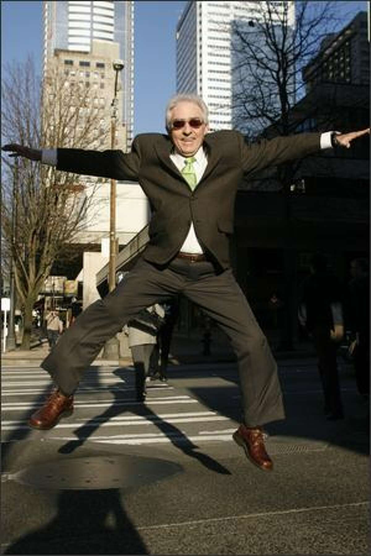 HIGH PRAISE -- Jerry Roberts, a jewelry appraiser leaps on 4th Ave. in Seattle.