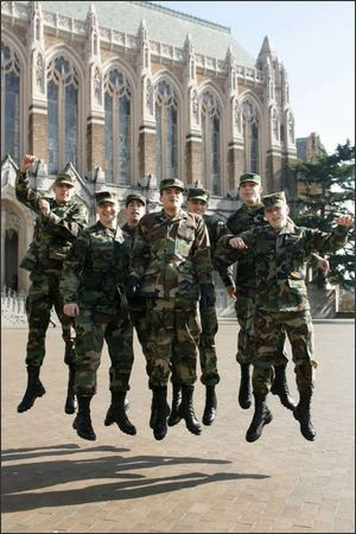 AIRBORNE -- Air Force ROTC cadets, from left, Vince Aqudelo, John Geis, Kelly Sullivan, Peter Murray, Christopher Pope, Christopher Birge and Nathan Isaman leap in honor of leap day at the University of Washington's Red Square.