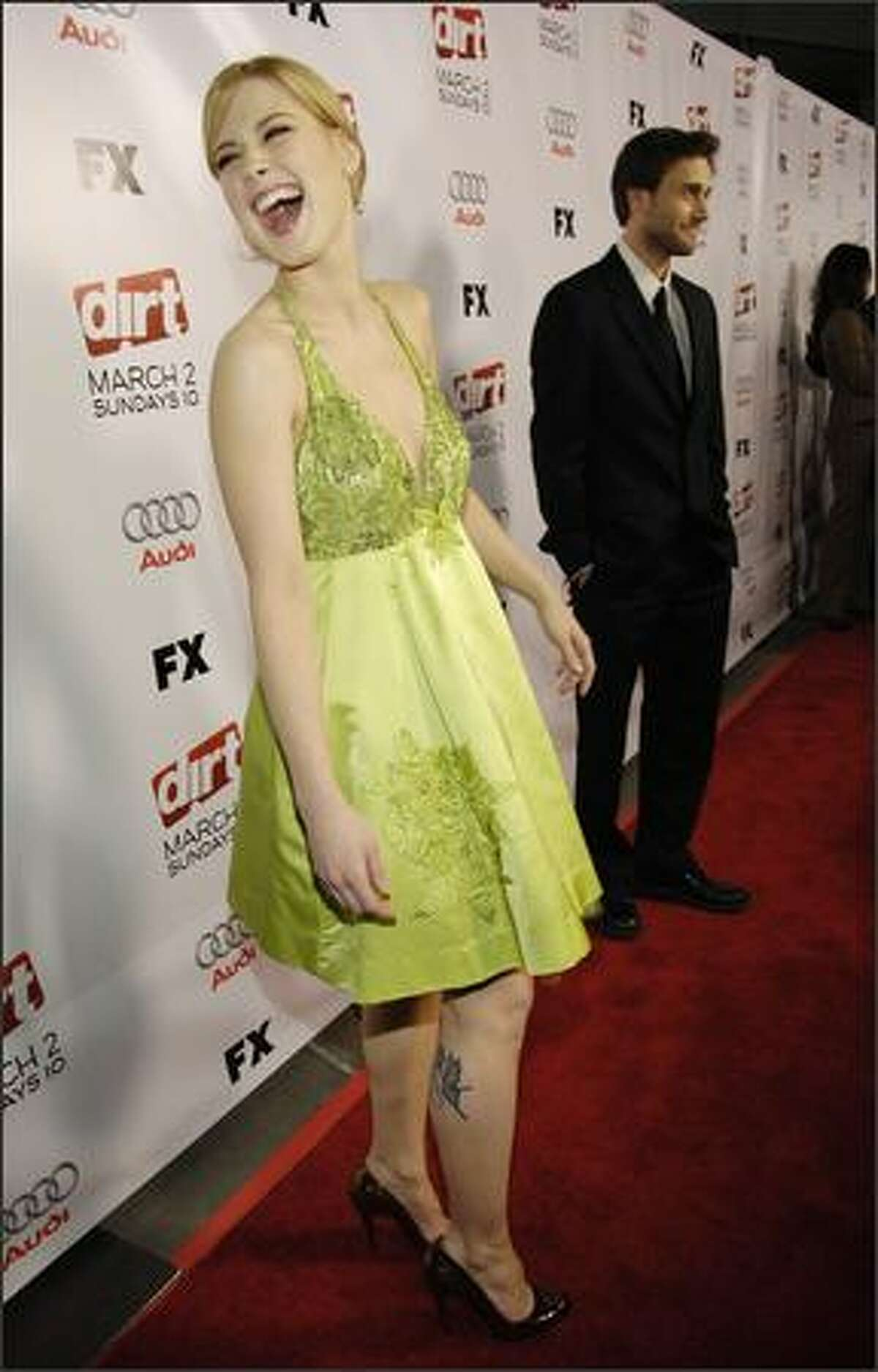 """""""Dirt"""" cast members Alexandra Breckenridge, left, and Ryan Eggold arrive at the season two premiere screening of the FX show, in Los Angeles, Thursday. (AP Photo/Chris Pizzello)"""