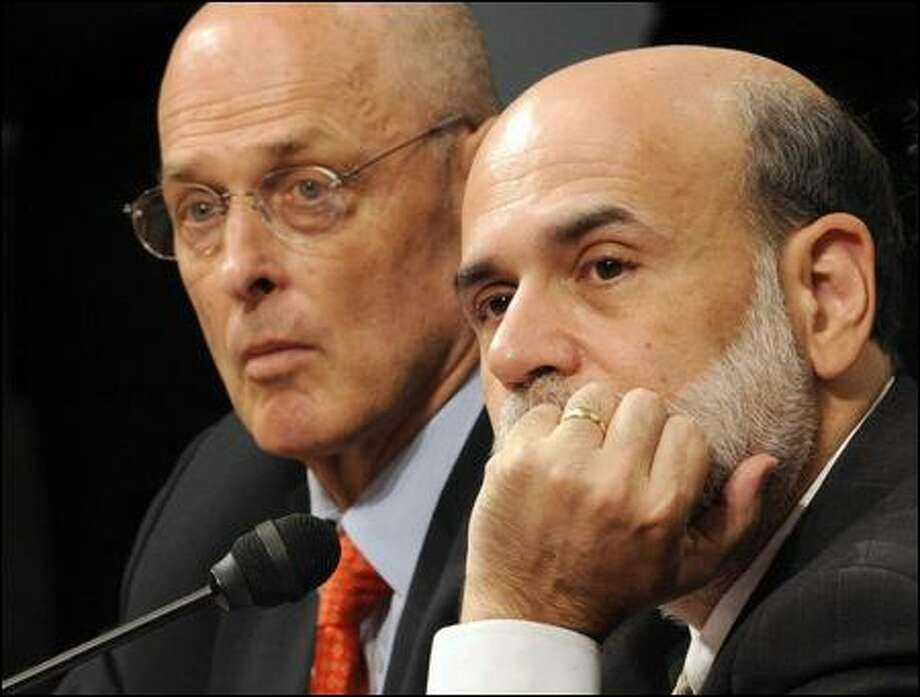 Treasury Secretary Henry Paulson, left, and Fed Chairman Ben Bernanke painted a dire picture of what would happen to the U.S. economy if a bailout is not enacted quickly. Photo: Susan Walsh/Associated Press
