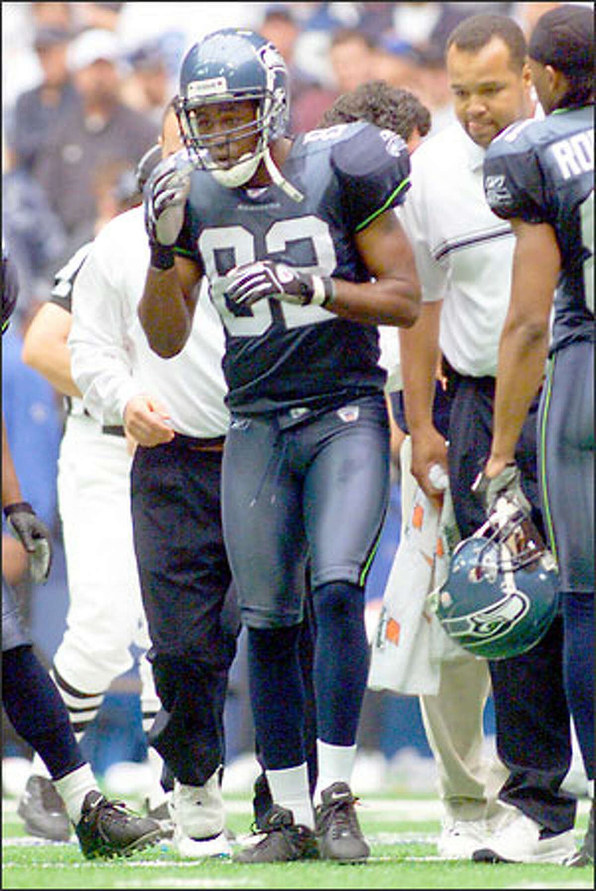 Wide receiver Darrell Jackson wobbles off the field after being struck in the helmet and jaw by Cowboys strong safety Darren Woodson. He later suffered a seizure in the locker room and was taken to the hospital.