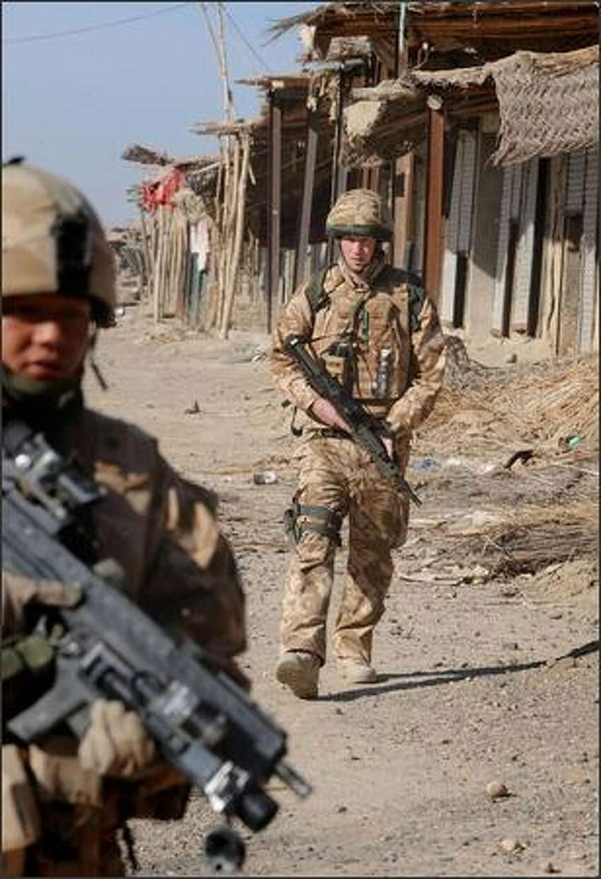 In this photo made available Sunday March 2, 2008, Britain's Prince Harry, right, on patrol through the deserted town of Garmisir Jan. 2, 2008, close to FOB (forward operating base) Delhi, where he was posted in Helmand province Southern Afghanistan.