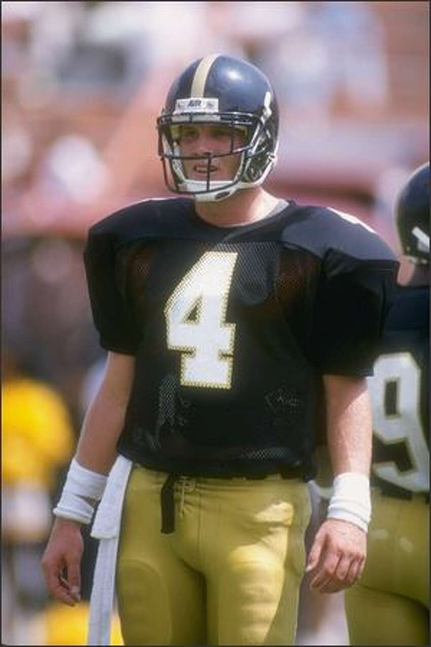 Quarterback Brett Favre, of the Southern Mississippi Golden Eagles, looks to the sideline during the Golden Eagles 30-26 victory over the Florida State Seminoles at Roberts Stadium in Hattiesburg, Mississippi, Sept. 2, 1989.