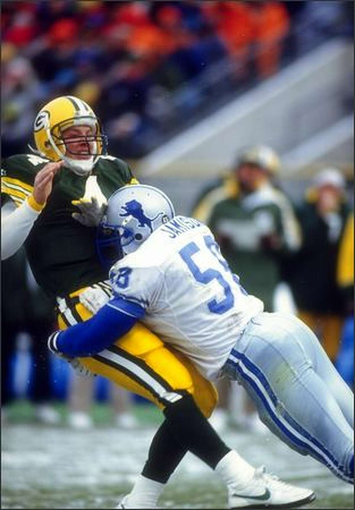 Defensive lineman George Jamison of the Detroit Lions sacks Green Bay Packers quarterback Brett Favre during a game at Milwaukee County Stadium in Milwaukee, Wisconsin, Dec. 6, 1992. The Packers won the game, 38-10.