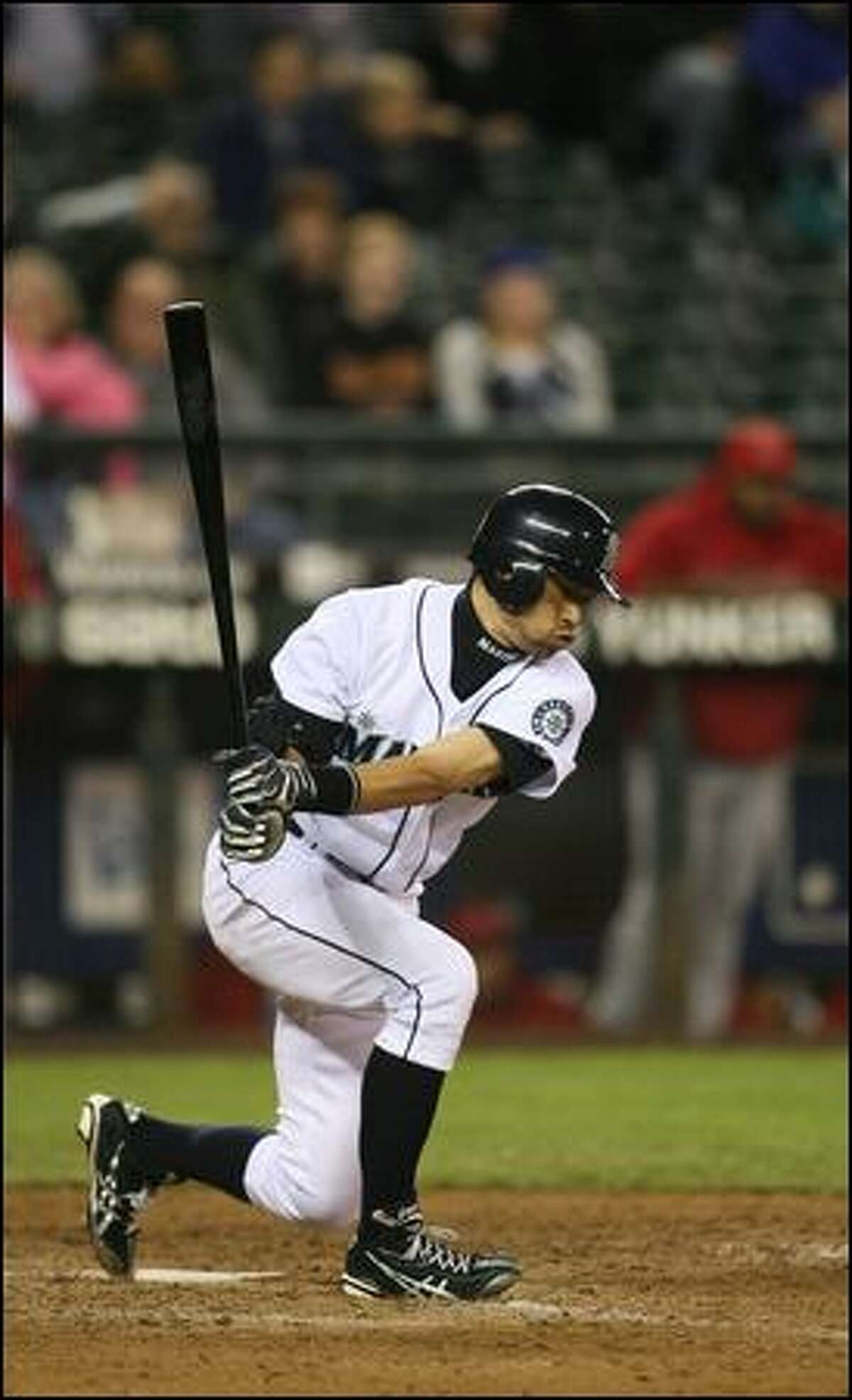 Ichiro Suzuki strikes out with the bases loaded in the eighth inning. The Mariners failed to score despite loading the bases with one out.