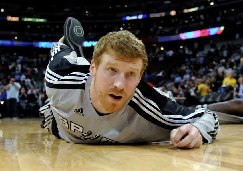 San Antonio Spurs forward Matt Bonner stretches before the Spurs' NBA basketball game against the Denver Nuggets on Wednesday, March 23, 2011, in Denver.