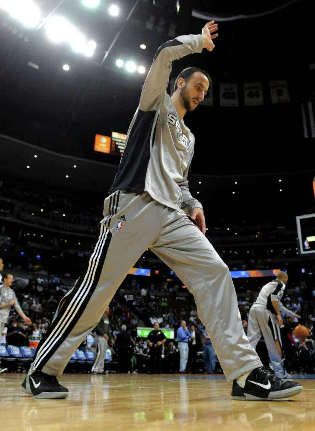 San Antonio Spurs guard Manu Ginobili, from Argentina, stretches before the Spurs' NBA basketball game against the Denver Nuggets on Wednesday, March 23, 2011, in Denver.
