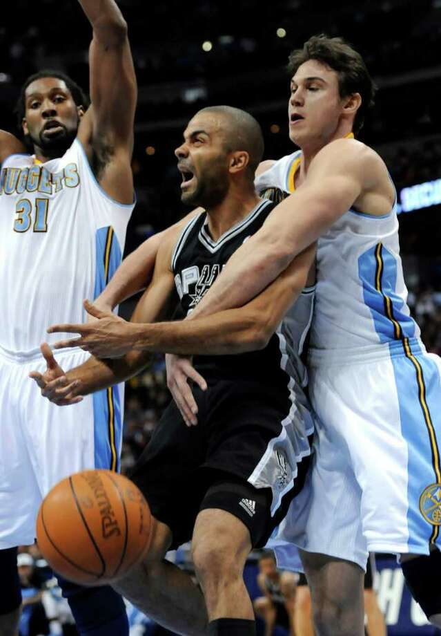 Denver Nuggets forward Danilo Gallinari (8), from Italy, fouls San Antonio Spurs guard Tony Parker (9), from France, as Nuggets center Nene (31), from Brazil, looks on during the first quarter of an NBA basketball game Wednesday, March 23, 2011, in Denver. Photo: AP