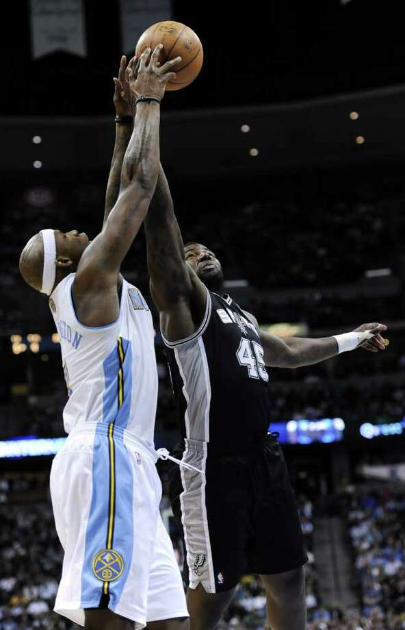 Denver Nuggets forward Al Harrington, left, and San Antonio Spurs forward DeJuan Blair (45) go after a rebound during the first quarter of an NBA basketball game Wednesday, March 23, 2011, in Denver. Photo: AP