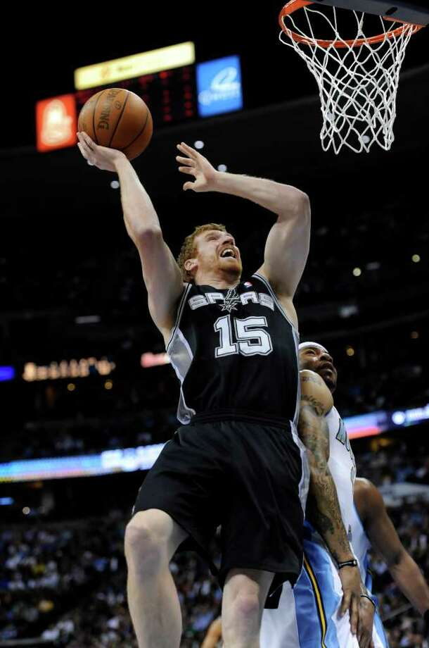 San Antonio Spurs forward Matt Bonner (15) shoots against Denver Nuggets forward Kenyon Martin during the first quarter of an NBA basketball game Wednesday, March 23, 2011, in Denver. Photo: AP