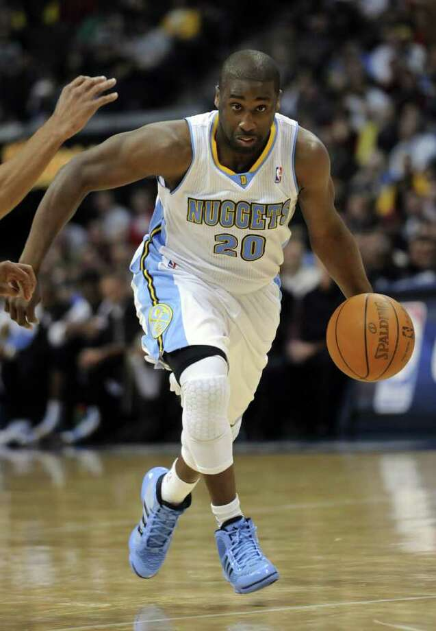 Denver Nuggets guard Raymond Felton (20) dribbles the ball against the San Antonio Spurs during the third quarter of an NBA basketball game Wednesday, March 23, 2011, in Denver. Photo: AP