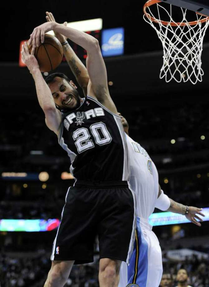 San Antonio Spurs guard Manu Ginobili (20) from Argentina pulls a rebound from Denver Nuggets forward Kenyon Martin (4) during the third quarter of an NBA basketball game Wednesday, March 23, 2011, in Denver. Photo: AP