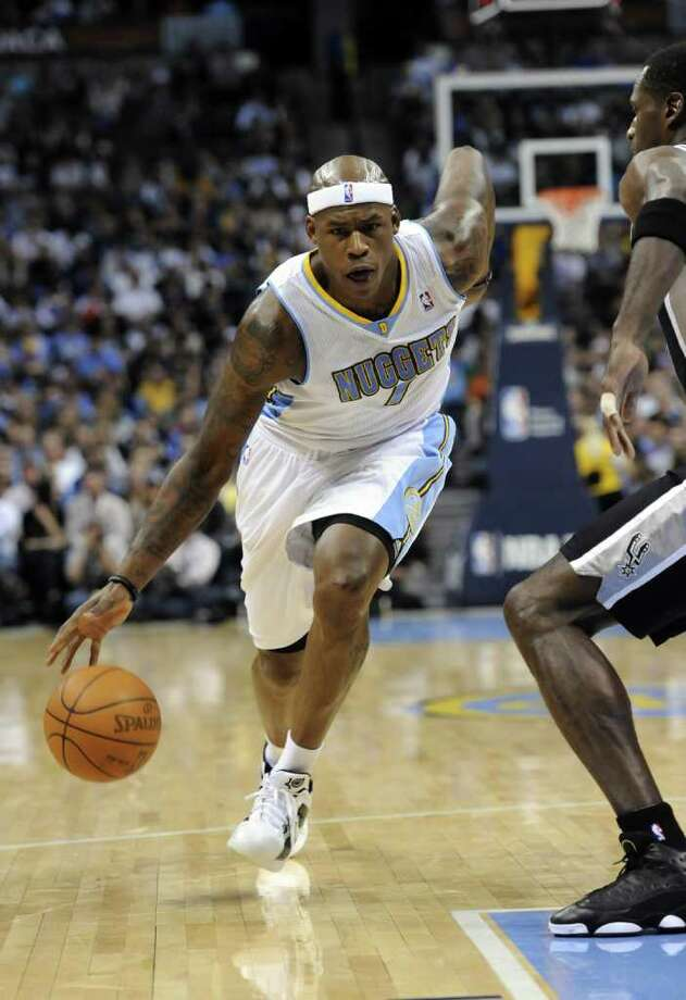 Denver Nuggets forward Al Harrington (7) drives to the basket against San Antonio Spurs forward Antonio McDyess (34) during the fourth quarter of an NBA basketball game Wednesday, March 23, 2011, in Denver. Denver beat San Antonio 115-112. Photo: AP