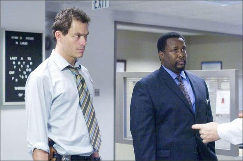 """The Wire,"" on HBO for five seasons, starred Dominic West, left, and Wendell Pierce as Baltimore police detectives. It ended in 2008.  Photo: HBO"